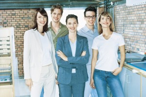 Employees Standing in Office --- Image by © P. Winbladh/Corbis